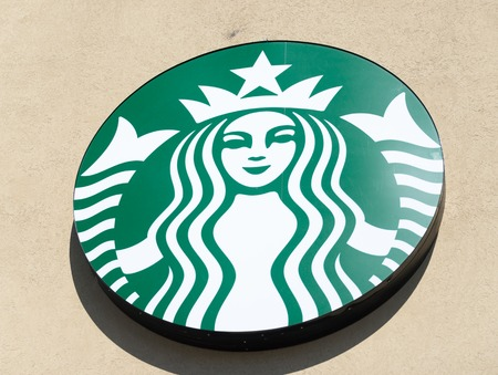 famous industries: CloseUp of a logo on the wall of a starbucks coffee shopStarbucks corporation doing business as starbucks coffee is an American global coffee companyIt is the largest coffeehouse company in the world