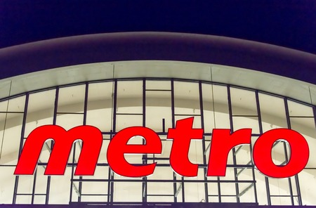 retailer: Closeup of the Metro signageToronto. Metro is a food retailer operating in Quebec and Ontario. The company based in Montreal is the third largest grocer in Canada