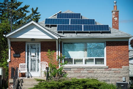 energy use: Solar energy panels in private house practical  use of solar energy is becoming more popular in Canada some houses and transit signals are using the technology on an everyday basis