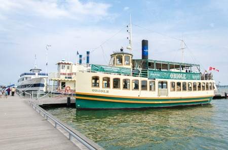 oriole: Oriole tourist cruise operating in the city harborfront in a day with blue sky