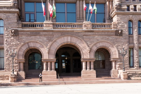 gov: Richardsonian Romanesque Architecture: entrance with arches and columns on the facade of the Ontario Legislative Building.   The Ontario Legislative Building is a structure in central Toronto, Ontario, that houses the viceregal suite of the Lieutenant Gov