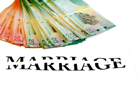 rupture: The cost of divorce: bunch of Canadian bills or money with a broken word Marriage over white background Stock Photo