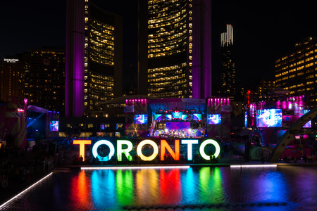 Toronto Pan American Games 2015 ambience: Nathan Phillips Square during Panamania, the cultural festival that goes along the games. Beautiful Toronto sign and the New City Hall in the background
