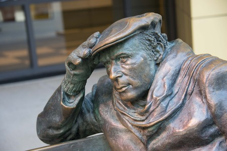 cbc: Close-up of Life-sized bronze statue of Glenn Gould, sitting on a park bench outside the CBC Building in downtown Toronto.