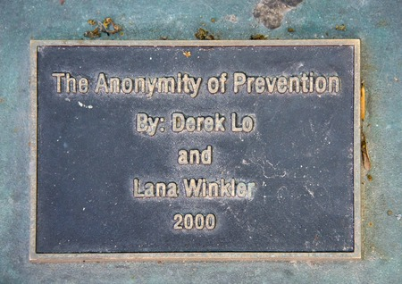 anonymity: Plaque at the WSIB Simcoe park workers monument with the words The Anonymity of Prevention Derek Lo and Lana Winkler 2000. The Anonymity of prevention bronze statue showing a worker working with a chisel and hammer with safety goggles at WSIB Simcoe Park