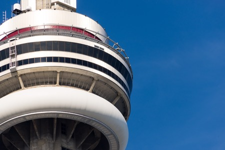 building cn tower: Close up of main pod of Toronto CN Tower. The CN Tower is a 553.33 meter high concrete communications and observation tower in Downtown Toronto, Canada.