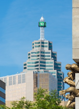 tog: The TD Canada Trust tower on the Brookfield Place with The Audience sculpture on Rogers Centre in the foreground. Brookfield Place is an office complex in downtown Toronto consisting of two towers, Bay Wellington Tower and TD Canada Trust Tower linked tog