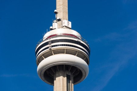 building cn tower: Close up of main pod of Toronto CN Tower against clear blue sky. The CN Tower is a 553.33 meter high concrete communications and observation tower in Downtown Toronto, Canada. Editorial