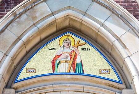 beliefs: The arch of Saint Helen Catholic Church depicting Saint Helen holding the cross. St. Helens is one of the largest Catholic church in Toronto.