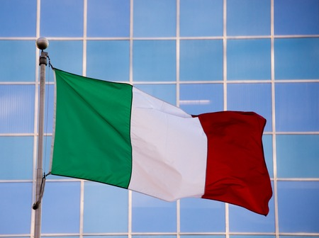 pales: National flag of Italy. It is a tricolor featuring three equally sized vertical pales of green, white, and red, with the green at the hoist side. Stock Photo