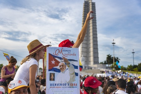 specifically: Scenes of Pope Francis to Havana, specifically the historic Catholic Mass held in the Revolution Square. Papa Francisco sign contrasted with the Revolution Square