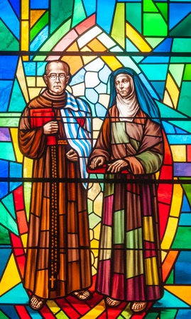 catholic stained glass: Catholic image in stained glass.  Joseph and the Virgin Mary are surrounded by colorful glass at the Annunciation Catholic Church in Toronto.