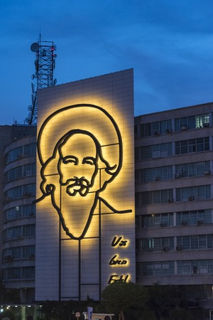 papal audience: Sculpture of Camilo Cienfuegos in the Communication Ministry Building during the visit of Pope Francis to Havana, specifically the historic Catholic Mass held in the Revolution Square.
