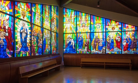 depict: Inside details of Annunciation Catholic Church.  Colorful Stained glass windows depict scenes from the Bible for in Toronto.