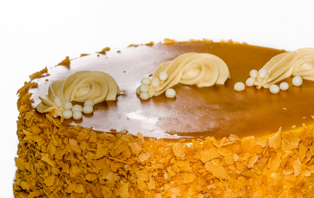 mouth watering: Beautiful and mouth watering caramel and apple cake.  Swirls of frosting decorate the orange-brown surface of the cake, while nuts adorn the side.