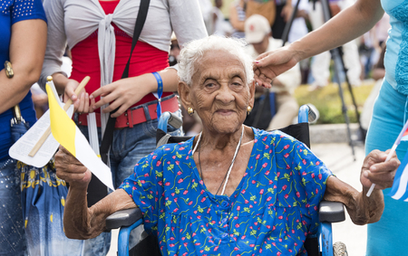 nine years old: Scenes of Pope Francis to Havana, specifically the historic Catholic Mass held in the Revolution Square.Hundred and nine years old Cuban senior woman attends to the Mass