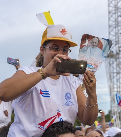 Scenes of Pope Francis to Havana, specifically the historic Catholic Mass held in the Revolution Square. Public filming the entrance of the Papa Francisco with their phones.General public attending the religious mass.
