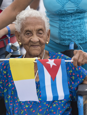 nine years old: Scenes of Pope Francis to Havana, specifically the historic Catholic Mass held in the Revolution Square. Hundred and nine years old Cuban senior woman attends to the Mass Editorial