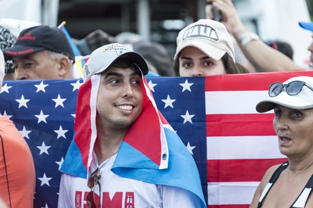 specifically: Scenes of Pope Francis to Havana, specifically the historic Catholic Mass held in the Revolution Square. USA flags are in style in Cuba, Cubans enjoying the new ways of tolerance.
