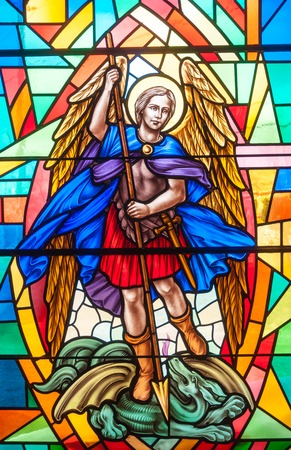 catholic stained glass: Catholic image in stained glass.  The Archangel Gabriel is depicted in colorful stained glass at the Annunciation Catholic Church in Toronto. Editorial