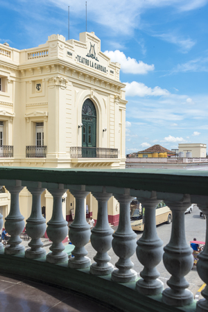 Spanish Colonial architecture in Cuba: Teatro La Caridad in Santa Clara, Cuba. The monument is a colonial theatre built in 1885. It is a National Monument of Cuba. View of Teatro La Caridad from the balcony of an adjacent building with railings in the for