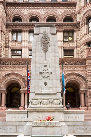 worl: The cenotaph in front of the old city hall in Toronto. The memorial is made of granite blocks and has the words, To Our Glorious Dead written on it. It was built to commemorate the Torontonians who lost their lives in services for Canada during the Worl