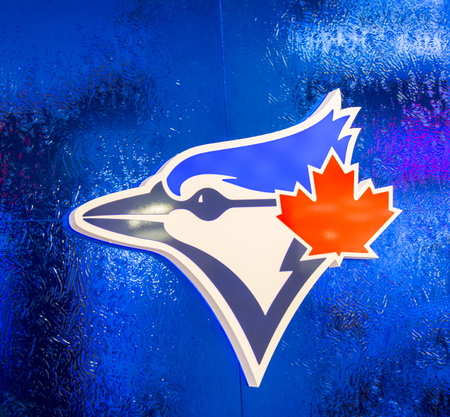 canadian maple leaf: Logo of the Toronto Blue Jays baseball team on a blue frosted glass. The logo features the head of the Blue Jay bird and the Canadian maple leaf in red. The Toronto Blue Jays are a Canadian professional baseball team based in Toronto, Ontario. The Blue  Editorial