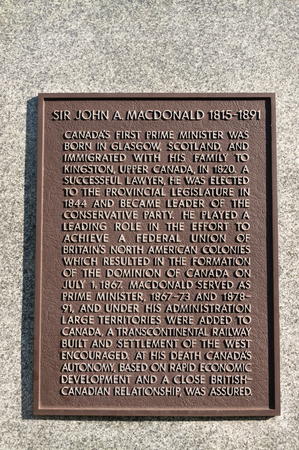 the prime minister: A stone carved plaque with a brief life history of Sir John A. Macdonald. Sir John Alexander Macdonald was a Scottish-born Canadian politician and Father of Confederation who was the first Prime Minister of Canada.