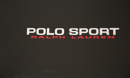 polo sport: Polo Sport - Ralph Lauren written on a black background in white and red. Ralph Lauren Corporation began with the 1967 founding of the Polo Ralph Lauren company by American designer Ralph Lauren. Editorial
