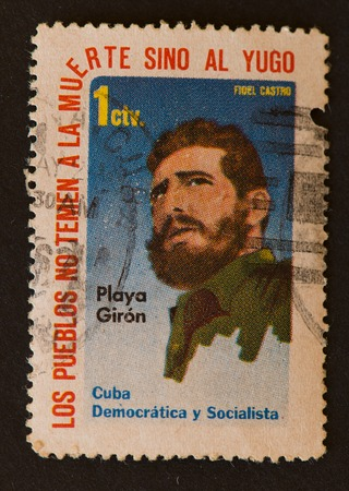 our people: Cuban stamp showing a portrait of Fidel Castro with the phrase Los pueblos no temen a la muerte sino al yugo meaning our people do not fear death, but the yoke. The stamp also refers to Democratic and socialist Cuba.