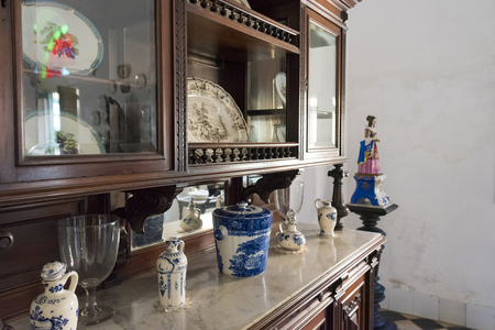 fled: The Dining hall at Museo de Arte Colonial, Sancti Spiritus, Cuba. Antique crockery and glass articles on display.  The museum is the opulent former palatial mansion of the Valle Iznaga clan, one of Cubas most elite families who fled Cuba after Fidels Re