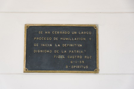 Words of great leader: A plaque reading the words spoken by Fidel Castro Ruz fixed on the Ruben Martinez Villena library in Sancti Spiritus, Cuba.  The plaque talks about the end of a long process of humiliation and beginning of ultimate dignity of the mo Redakční