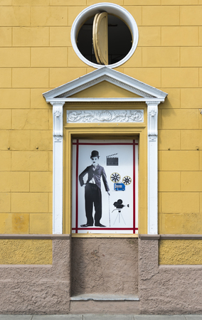 chaplin: Conrado Benitez Cinema theater in Plaza San Francisco, Sancti Spiritus, Cuba. Antique design with image of Charlie Chaplin on the facade of the building.  The theater is named after a voluntary teacher Conrado Benitez Garcia, who also served as an informa Editorial