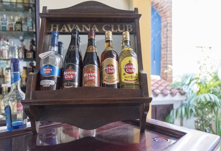 cuban culture: El Ron de Cuba: Different varieties of Havana Club rum bottles on display at a bar.  Havana Club brand of rum created in 1934, is one of the best-selling rum brands in the world and also promotes Cuban culture across the globe.