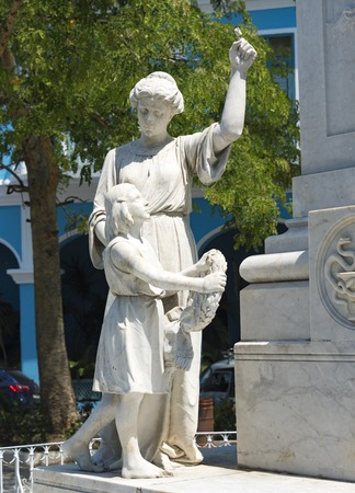 illustrious: Statues of a lady, and a girl laying wreath at the statue of Dr. Rudesindo Antonio Garcia Rijo at Honorato Park, Sancti Spiritus, Cuba.  The statue was built as a tribute to his virtues of gratitude and justice.  Dr. Rijo was as an outstanding figure of t
