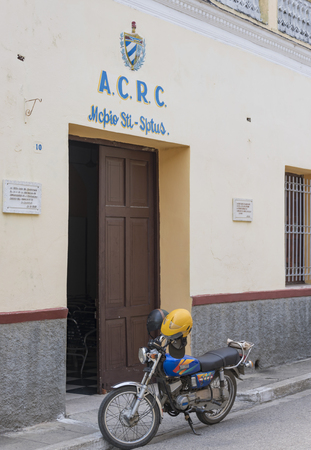 socialism: The Asociacion de Combatientes de la Revolucion Cubana, or ACRC office in Sancti Spiritus, Cuba.  Association of Combatants of the Cuban Revolution is a self-financed and voluntarily social organization to bring socialism in all fields.