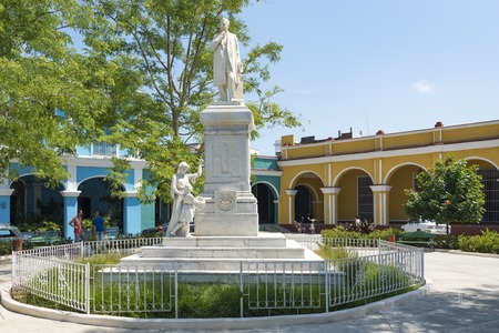 humanist: Statue of Dr. Rudesindo Antonio Garcia Rijo at the Honorato Park, Sancti Spiritus, Cuba. The statue is built on a high pedestal. Statues of a lady, and a girl laying wreath is at the base of the pedastal.  Dr. Rijo was as an outstanding figure of the 19th
