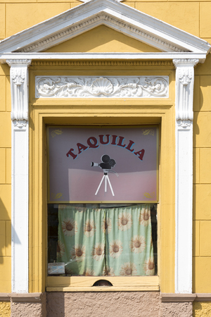 voluntary: Conrado Benitez Cinema theater in Plaza San Francisco, Sancti Spiritus, Cuba. Antique design on the facade of the building and the ticket booking office.  The theater is named after a voluntary teacher Conrado Benitez Garcia, who also served as an informa Editorial