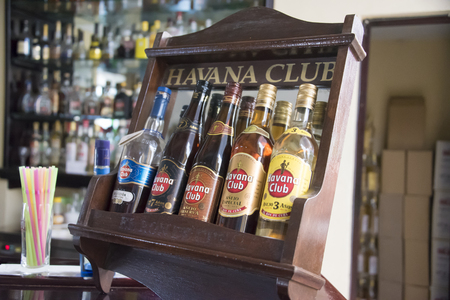 ron: El Ron de Cuba: Different varieties of Havana Club rum bottles on display at a bar.  Havana Club brand of rum created in 1934, is one of the best-selling rum brands in the world and also promotes Cuban culture across the globe.
