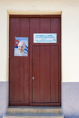 Mother Teresa: Welcoming the Pope to Cuba: Poster outside the office of Missionaries of Charity of Mother Teresa of Calcutta, in Sancti Spiritus, Cuba.  The Pope visited Cuba from September 19 to 22, 2015.