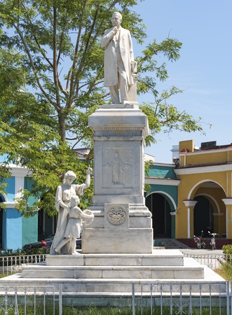 illustrious: Statue of Dr. Rudesindo Antonio Garcia Rijo at the Honorato Park, Sancti Spiritus, Cuba. The statue is built on a high pedestal. Statues of a lady, and a girl laying wreath is at the base of the pedastal.  Dr. Rijo was as an outstanding figure of the 19th