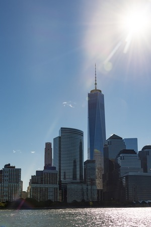 rebuild: The New World Trade Center in the New York City skyline. Tourist view from one of the cruises that goes to the Statue of Liberty.  At 1,776 feet tall, One World Trade Center  is the tallest building in the Western Hemisphere. Developed by The Port Authori