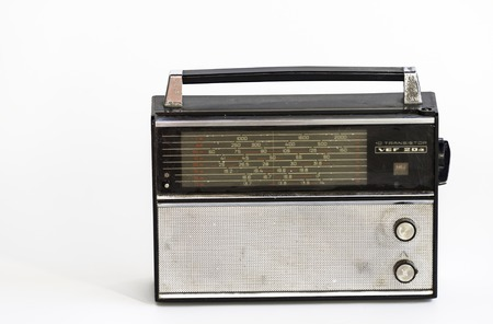 transistor: Old fashioned or vintage transistor radio on white background.  For almost a century, radio has shaped and advanced society like nothing that came before it. Stock Photo