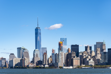 freedom tower: Attractions in New York City: the metropolis skyline including the One Trade Center building or the Freedom tower seen from a tourist cruise travelling to the Statue of Liberty.