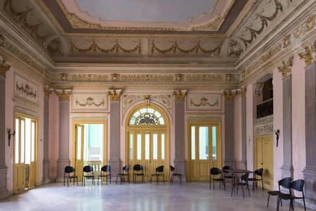 interior spaces: Colonial architecture in Cuba: House of Culture, interior detail, set in vintage luxurious building in the Leoncio Vidal Park, Santa Clara,Cuba House of culture are community spaces that spread the local culture for free.