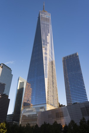 world trade: One World Trade Center building in New York city during day time. The 104-story landmark is the tallest skyscraper in the Western Hemisphere, and the fifth-tallest in the world.