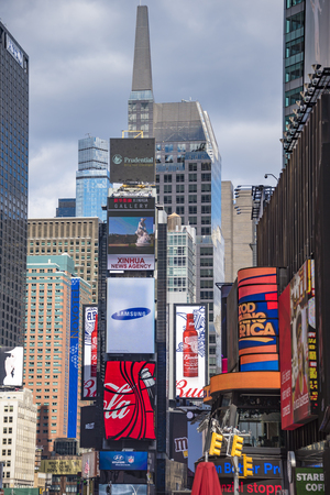 new york city times square: Times Square in New York City, Times Square is a major commercial intersection and neighborhood in Midtown Manhattan. The landmark is brightly adorned with billboards and advertisements. Times Square is sometimes referred to as The Crossroads of the World