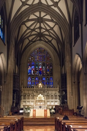 episcopal: Interior details Trinity Church in New York city. Beautiful stained glass and wooden surfaces. Trinity Church, at 75 Broadway in lower Manhattan, is a historic, active, well-endowed parish church in the Episcopal Diocese of New York. Stock Photo