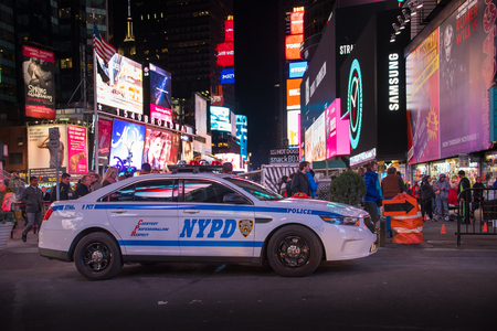new york time: NYPD police car in New York Times Square night scenes. The tourist landmark is visited by about 50 million tourists every year and is famous for counting down to the new year each year. Editorial