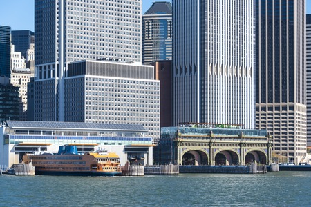 passenger ships: Manhattan cruise terminal or cruise port in New York with skyscrapers in the background.  New York Cruise Terminal is a terminal for ocean-going passenger ships on Manhattans West Side, in Hells Kitchen.